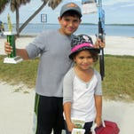 """Kids learn about fishing and win prizes at the free """"Ding"""" Darling Kids Fishing Derby on Saturday."""