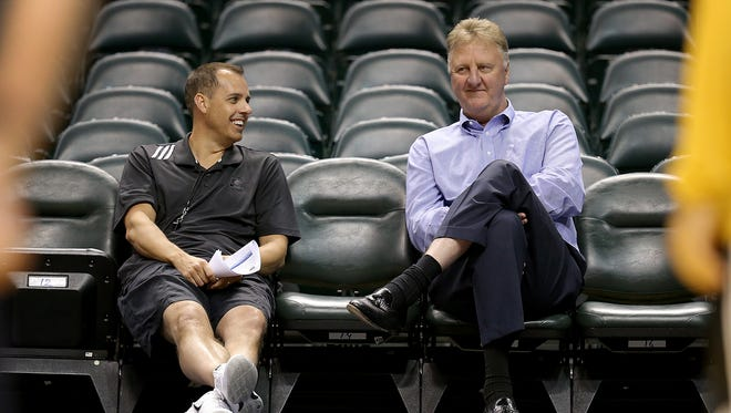 Indiana Pacers head coach Frank Vogel,left, shares a laugh with team president Larry Bird during their rookie workouts Tuesday, May 26, 2015, afternoon at Bankers Life Fieldhouse.
