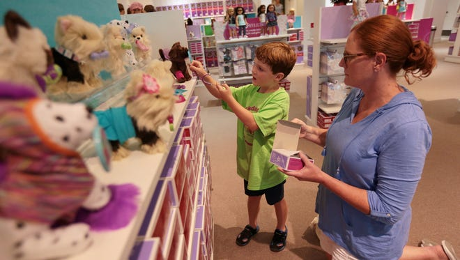 Carrie Estabrook, of South Lyon, MI, shops with her son, Mark Estabrook, 5, at the new American Girl store inside Twelve Oaks Mall on Friday, August 5, 2016, in Novi, MI.