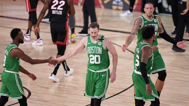 Boston Celtics Kemba Walker, left, Gordon Hayward (20), Marcus Smart (36) and Daniel Theis right rear, during the second half of Game 4 of the Eastern Conference finals Wednesday, Sept. 23, in Lake Buena Vista, Fla.