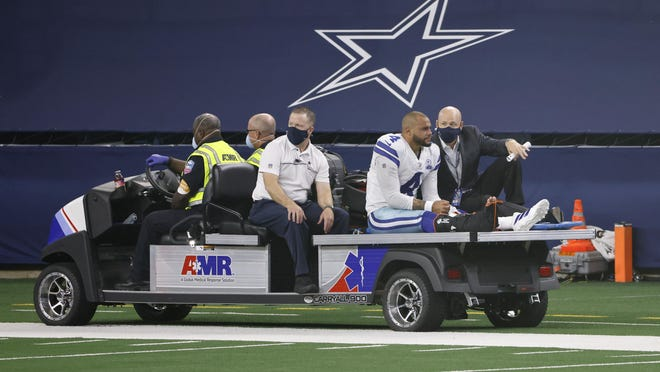 Dallas Cowboys quarterback Dak Prescott (4) is carted off the field after an injury during a game against the New York Giants in Arlington, Texas, on Oct. 11.
