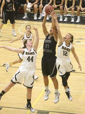 Centennial's Jaali Winters grabs the rebound as she battles Southeast Polk's Allee Ira and Ashton Donels for the ball.