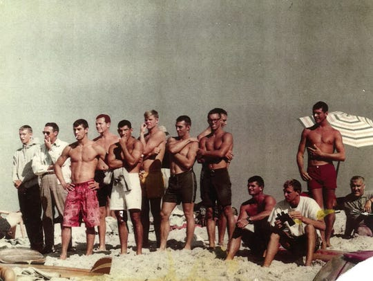 Smith, pictured far right, at the Gilgo Beach surf