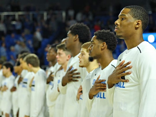 MTSU players stand for the National Anthem before their