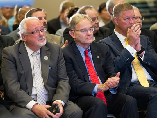 State Rep. Thomas Weatherston (from left), state Rep. Peter Barca and Metropolitan Milwaukee Association of Commerce President Timothy Sheehy listen during a news conference at the SC Johnson iMET Center in Sturtevant. The site for Foxconn Technology Group's $10 billion, 20-million-square-foot electronics factory was announced at the event.