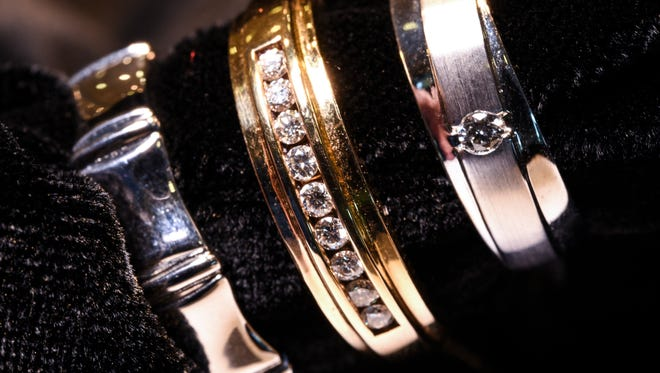 A trio of men's wedding bands photographed at Vince Jewelers in East Hagåtña on Thursday, Jan. 26, 2017.