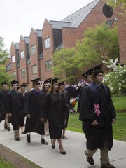 Graduates march into the Ross Sports Center to graduate at St. Michael's College on Sunday, May 12, 2013.