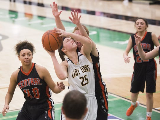 Red Lion's Courtney Dimoff drives to the hoop on Central York defenders Teirra Preston, left, and Emma Saxton, back. Red Lion defeats Central York 35-34 in the YAIAA girls' basketball championship game at York College, Friday, February 12, 2016.