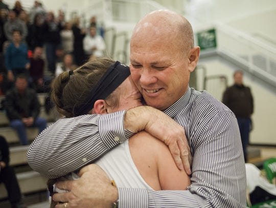Red Lion girls' basketball coach Don Dimoff hugs his