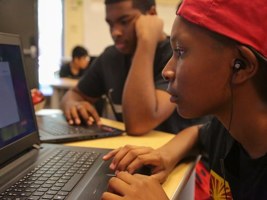 Todd Shaw, age 12, works on writing code during a summer