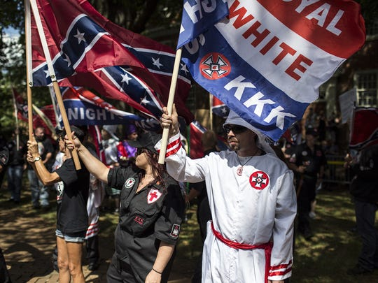 The Ku Klux Klan protests on July 8, 2017 in Charlottesville, Va. A South Carolina teacher, who was placed on leave after a homework assignment asking students to imagine being a member of the KKK after the Civil War, returned to the classroom Friday, Sept. 22, 2017.
