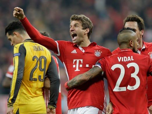 Bayern's Thomas Mueller celebrates after scoring his