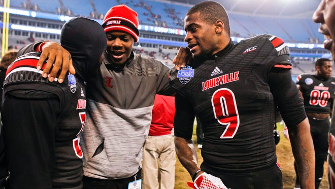 Former Louisville quarterback and current Minnesota Vikings QB Teddy Bridgewater greets former teammates Charles Gaines, left, and Devante Parker after the Cardinals lost to Georgia in Belk Bowl. Matt Stone/The Courier-Journal