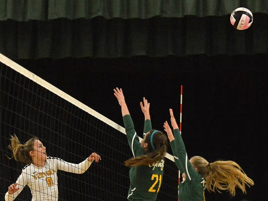 Ventura's Sammy Slater, left, hits the ball past La Reina's Nicole Orlow, middle, and Bethanie Blaise on Wednesday night at La Reina.