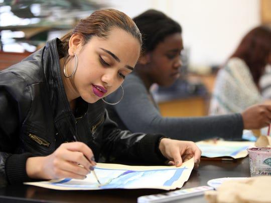Senior Yasuri Rosario, 18, and sophomore Larryshia Jones, 15, work on watercolor paintings at North Rockland High School.