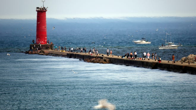 Pleasant warm weather drew people to walk the north pier near the lighthouse Thursday July 21, 2016 in Sheboygan.