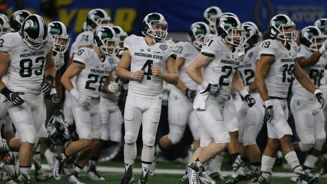 The Michigan State Spartans warm up before action against the University of Alabama in the Good Year Cotton Bowl game on Thursday, December 31,2015 at AT&T Stadium in Arlington, Texas.