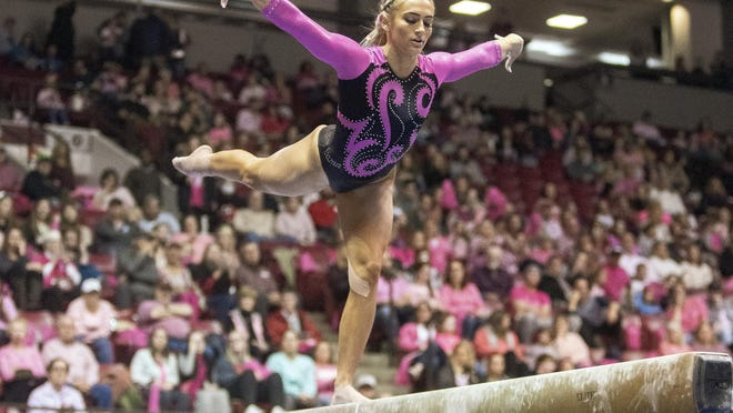 Lexi Graber poses on the balance beam during the NCAA gymnastics meet between the Alabama Crimson Tide and the Missouri Tigers at Coleman Coluseum  in Tuscaloosa, Ala. on Friday, Feb. 7, 2020.