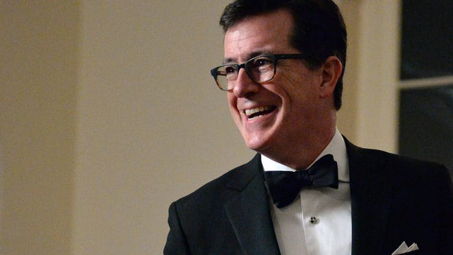 Comedian Stephen Colbert arrives at the White House earlier this year. The comedian was invited by President Barack Obama to sit at a head table at a state dinner in February.