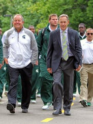 Michigan State athletic director Mark Hollis, left,