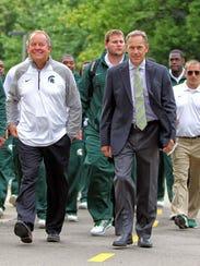 Michigan State athletic director Mark Hollis, left,