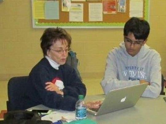 Vishnu Paranandi, right, helps a Wyoming resident learn