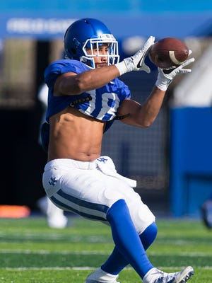 Kentucky Wildcats wide receiver Clevan Thomas Jr catches the ball during the Kentucky football open practice session.