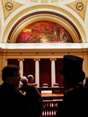 Visitors look inside Minnesota's supreme court chambers during public tours of the renovated building where the 2017 Legislature convened Tuesday in St. Paul.