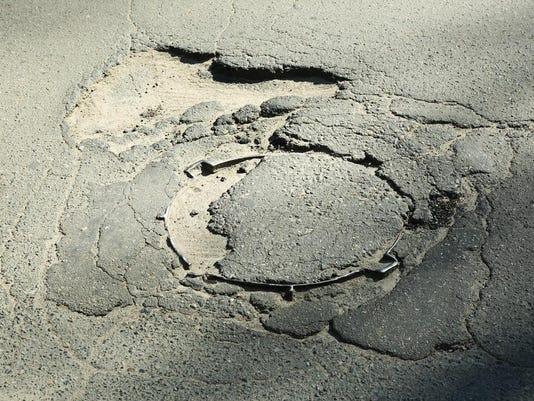 roads pothole stock