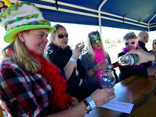 Beth Deatrick, left of Dallastown, celebrates her 28th birthday with friends Liz Flar of Hallam, Michelle Murr of Lancaster, and Connie Morris, right of Hanover, by enjoying an afternoon of sampling wine at the Jackson Square Vineyards booth during Yorktoberfest Beer and Wine Festival at the York Fairgrounds, Sunday October 11, 2015. John A. Pavoncello - jpavoncello@yorkdispatch.com