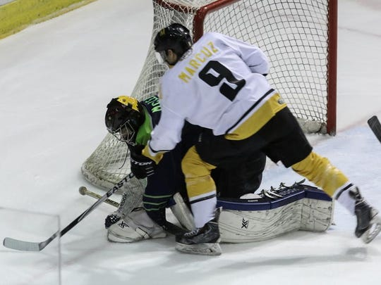Ryan Marcuz (9) gets stopped by former Ice Flyers goaltender John McLean during a game two seasons ago when Marcuz was with the Mississippi RiverKings. The veteran forward was signed by the Ice Flyers in the off-season.