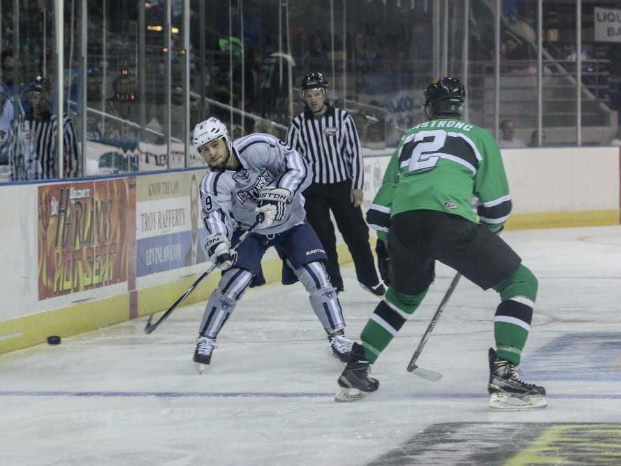 Stephen Buco, left, of the Ice Flyers gets the puck past Dan Cornell of the Lousiana IceGators during Friday night's game at the Pensacola Bay Center.