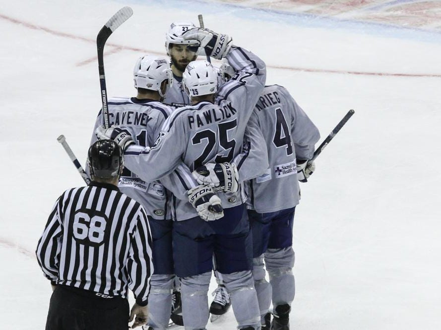 The Ice Flyers celebrate Adam Pawlick's goal during Friday night's game at the Pensacola Bay Center.