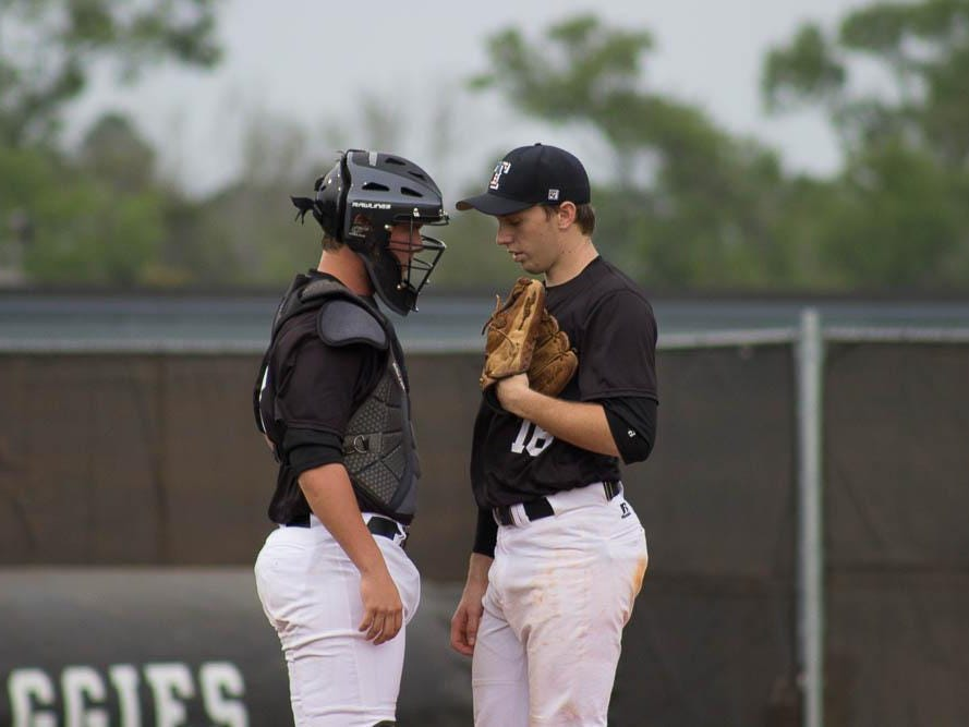 Tate's Cole Halfacre (left) and Jake Davis strategize mid-inning during Wednesday's game vs. Pace.