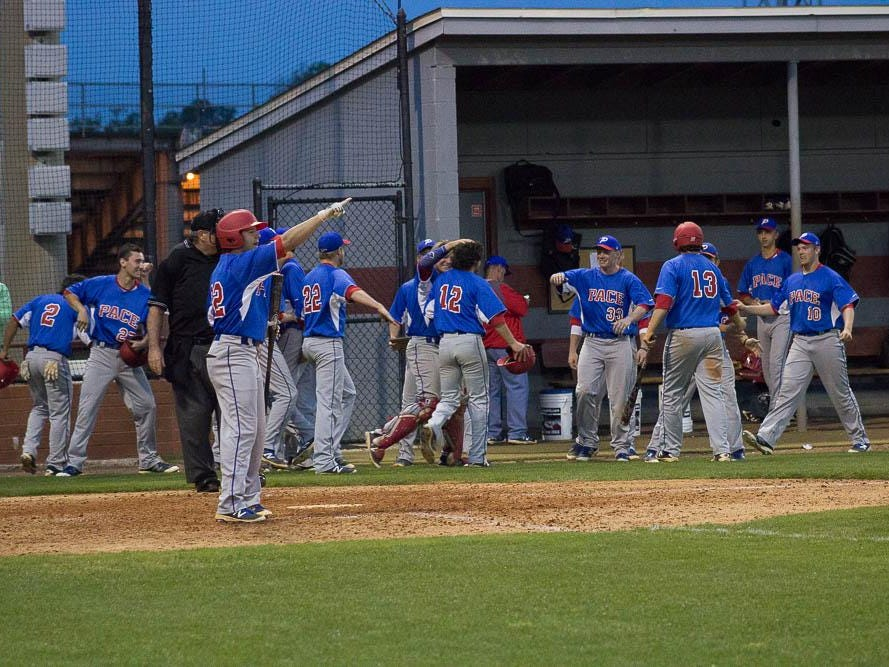 The Patriots celebrate their fierce comeback in the sixth inning.