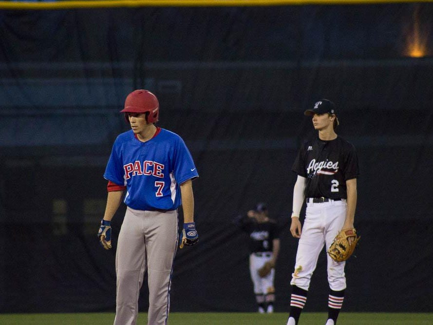 Chase Beckstrom leads off second base while Tate SS Branden Fryman watches.