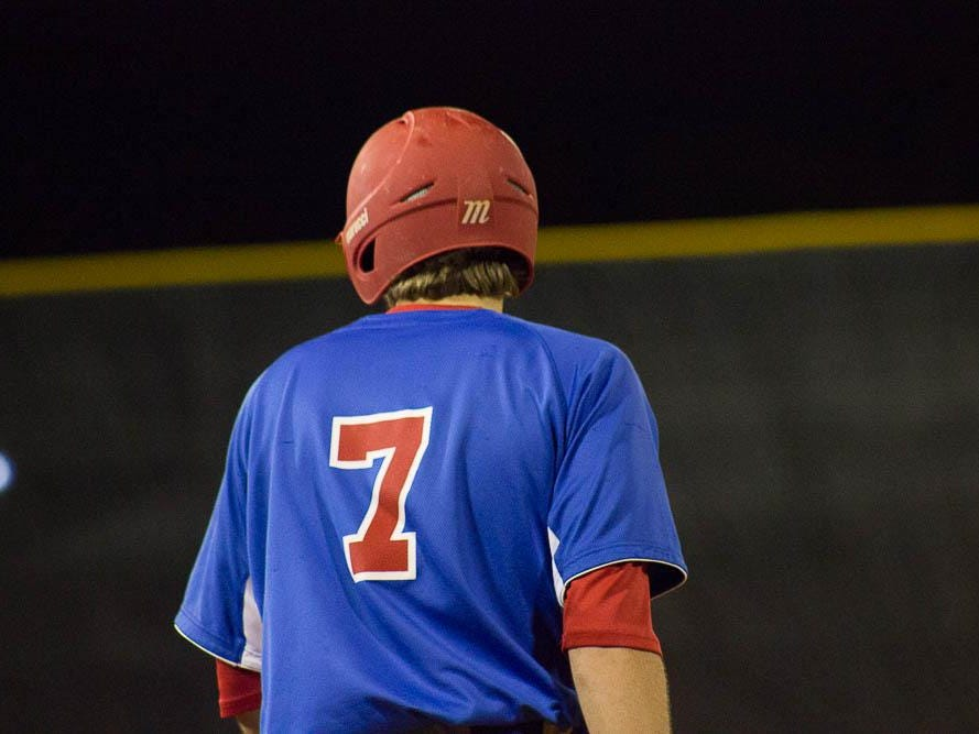 Chase Beckstrom awaits a hit-an-run scenario from first base during Wednesday night's game at Tate.