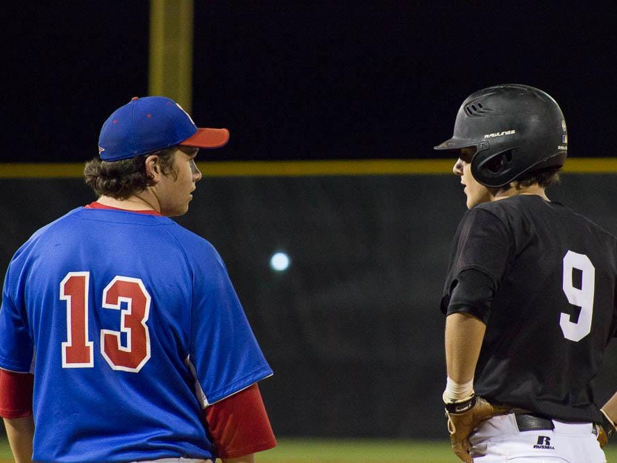 Pace's Dalton Childs and Tate's Mason Land have a chat at first base during Wednesday night's game at Tate.