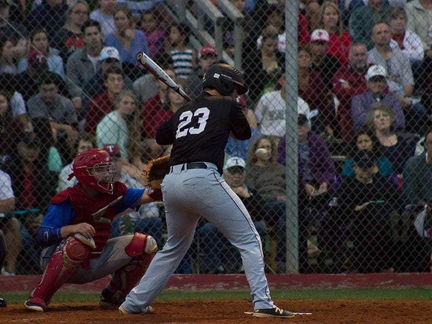Tate's Cole Halfacre attacks a pitch during Tate's district-championshp win over Pace.