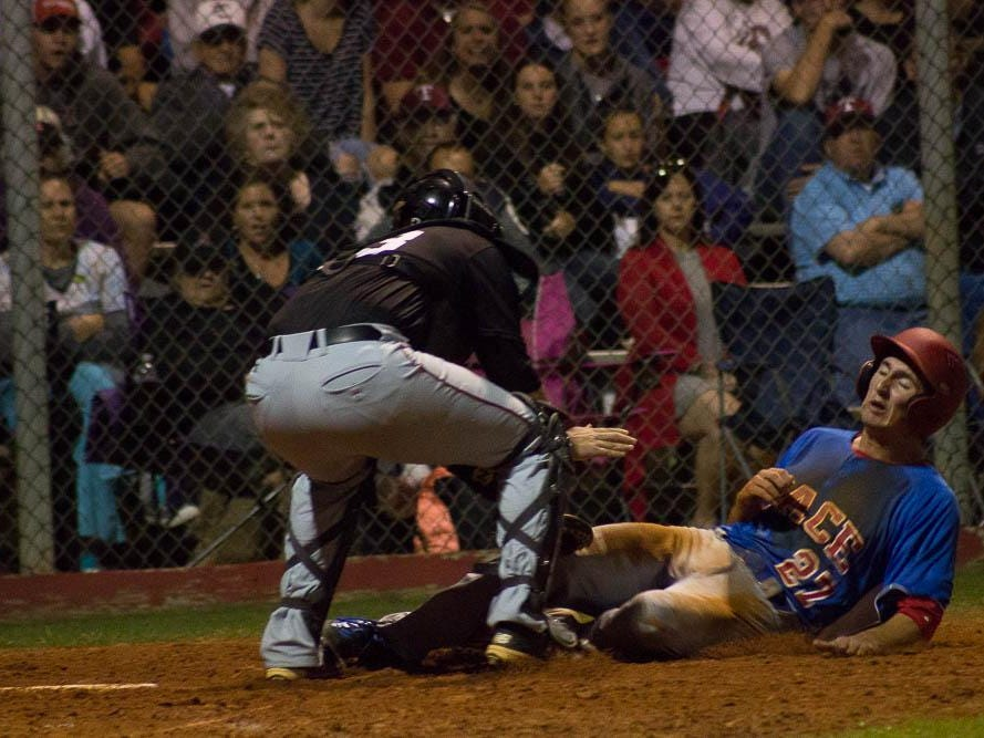 Tate's Cole Halfacre saves a run by tagging out Jason Barlow at the plate.
