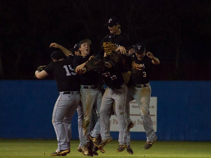 The Tate Aggies celebrate after ca1-7A title with a 3-1 win over Pace.