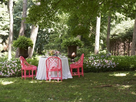 """A setting for lunch on the lawn, from """"Designing Life's Celebrations."""""""