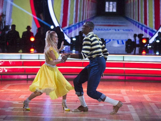 """Johnson and his pro partner Lindsay Arnold do the foxtrot to the """"Family Matters"""" theme song """"As Days Go By."""""""
