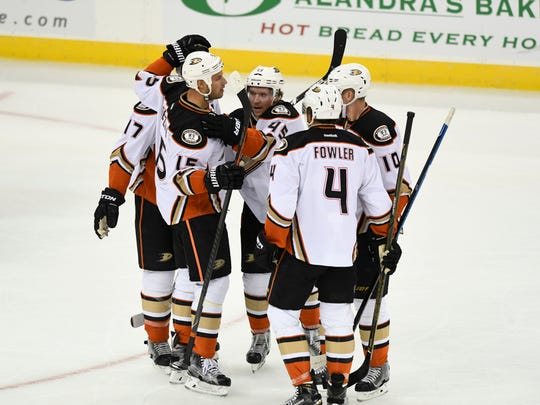 Ducks players surround defenseman Sami Vatanen (45) after his first goal in the first period, with an assist by Anaheim Ducks right wing Corey Perry (10).