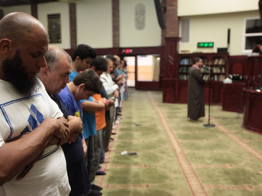 Abdul Basir of Bloomfield and other Muslim men pray during the al maghreb (sunset) prayer at the Islamic Center of Passaic County in Paterson in 2016.