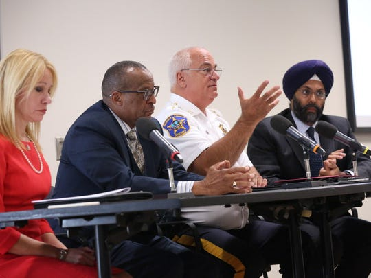 From left to right, Cliffside Park School Principal Dana Martinotti, Mount Olive Church Pastor Rev. Gregory Jackson, Bergen County Sheriff Michael Saudino, and Acting Bergen County Prosecutor Gurbir S. Grewal are shown during the forum at Bergen Community College on Wednesday, Oct. 5, 2016.