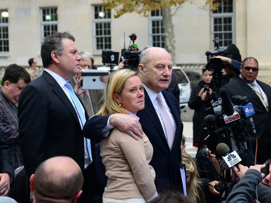 Michael Critchley, attorney, puts his arm around his client, Bridget Anne Kelly, as he speaks to the media outside federal court on Friday, Nov. 4, 2016.