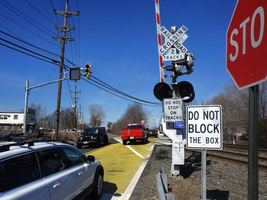 Yellow road tiles and signs warn drivers at the Midland Avenue rail crossing near the Elmwood Park-Saddle Brook border.