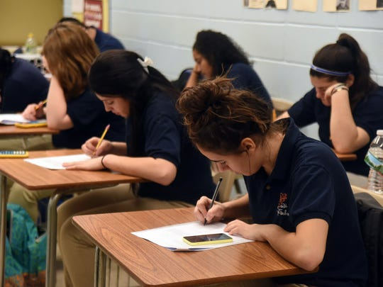 Students work on a math problem during an SAT prep class at Lodi High School.