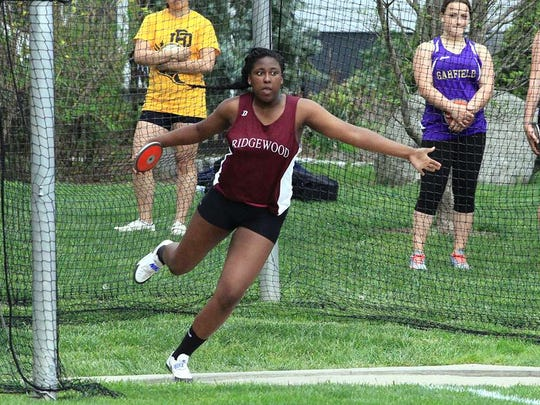 Lexi Uzoaru of Ridgewood winds up to throw the discus in the Bergen County Relays last week. The sophomore placed 10th in the event and added a third in the shot put to help the Maroons earn points crucial to winning the Division A title.